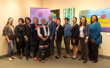 Grant recipients stand with Minister Kelly Regan, Minister Responsible for the Nova Scotia Advisory Council on the Status of Women (4th from left), Elder Marleen Companion (5th from left), and MP Andy Filmore (6th from left).